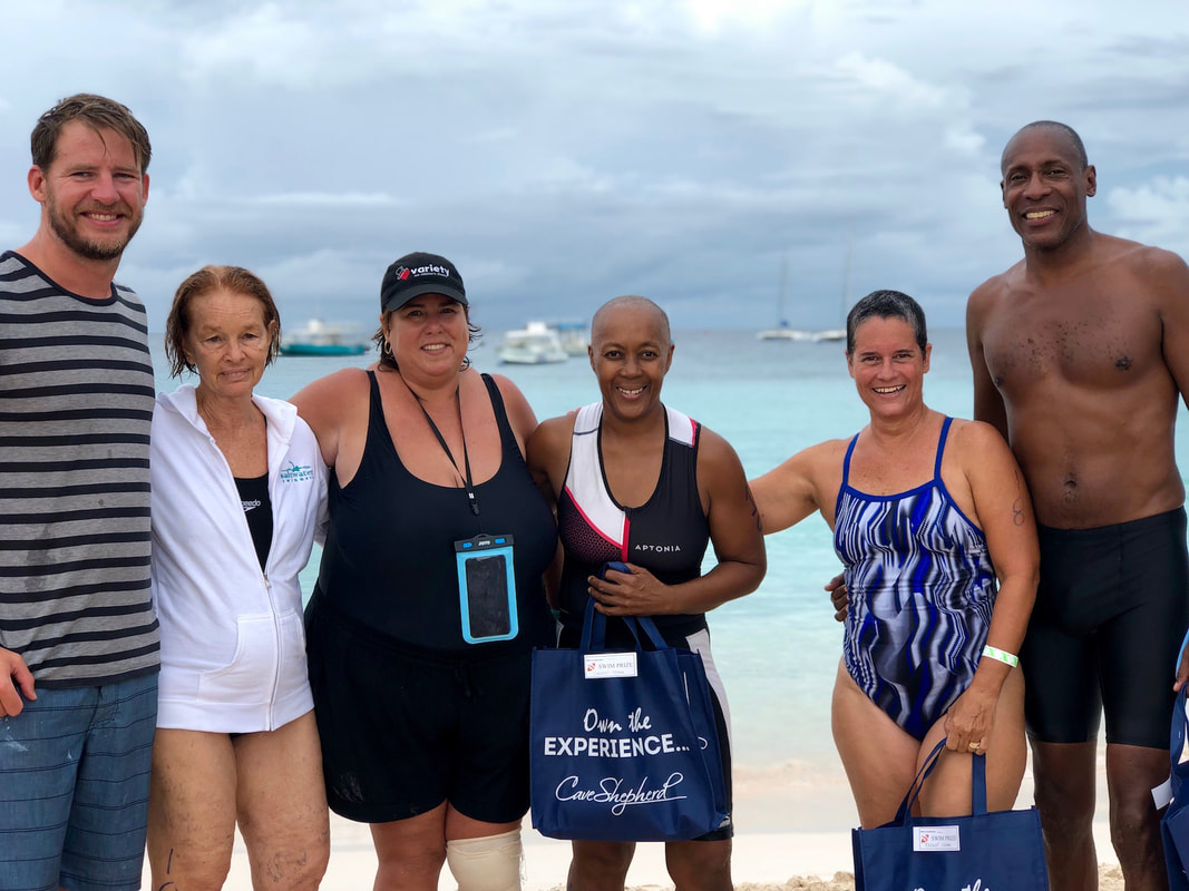 Cameron Bellamy and winning swimmers in Barbados