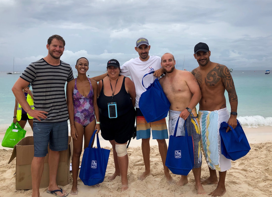Cameron Bellamy & winners at charity swim in Barbados